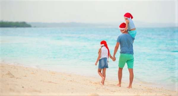 Family spending Christmas on the beach