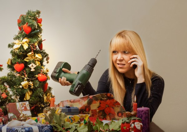 Woman on the phone while looking at bad Christmas present