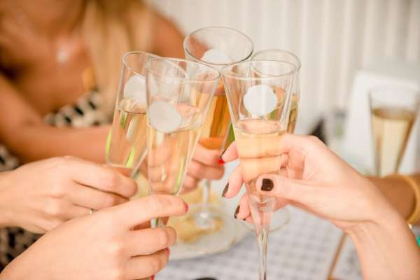 Women cheersing champagne glasses
