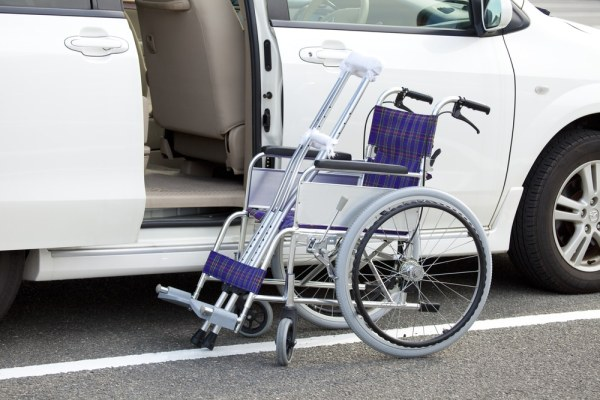 Wheelchair in front of car