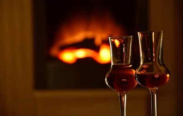 Glasses of whisky by the fire
