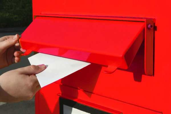 posting letter in post box