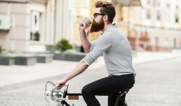 Hipster Cyclist Drinking Coffee