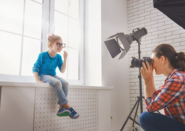Female photographer photographing little boy