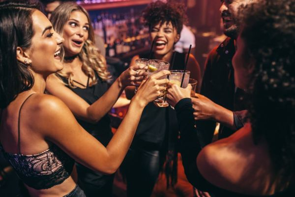 Group of girlfriends partying in a bar
