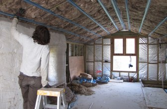 Man installing home insulation