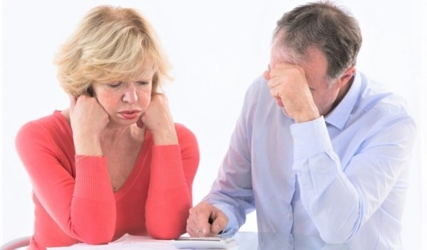 Worried couple working out finances
