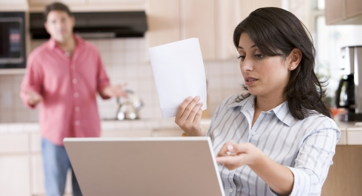 Worried couple assessing their finances