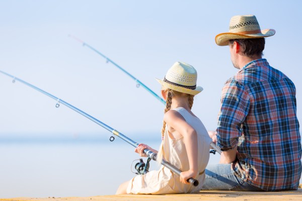 Father and daughter fishing on a dock