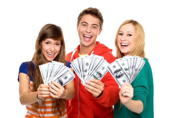 Teens holding cash