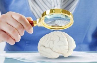 Woman holding magnifying glass over a brain