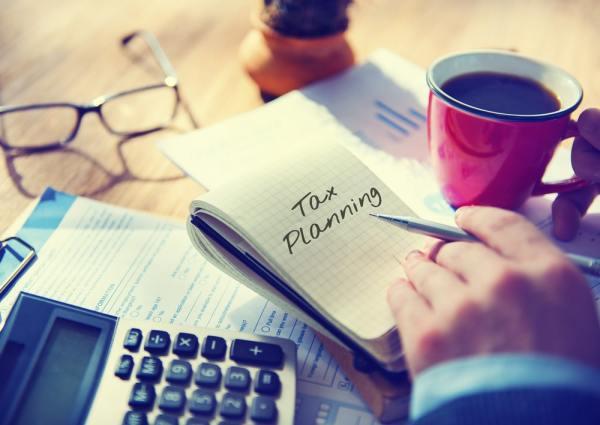 Tax planning written on a notepad