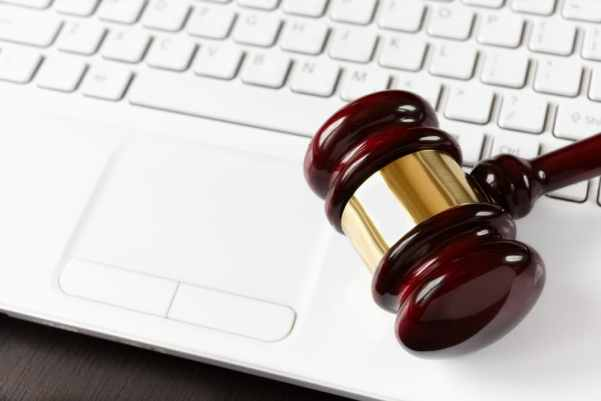 Laptop keyboard and auction gavel