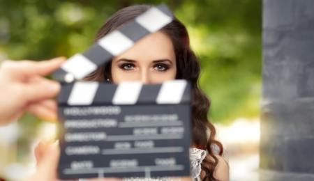 Actress behind a clapper board