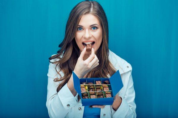 Woman eating chocolates