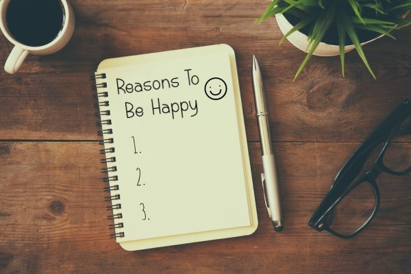 Reasons to be happy list in notebook