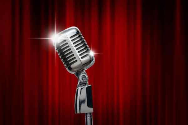 Microphone in front of red curtain