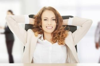 Business woman with hands behind her head smiling and relaxed