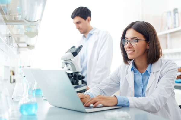 Female Scientist using laptop