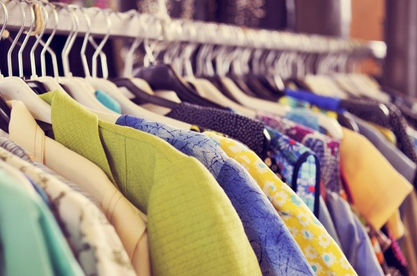 Rail of different clothes in a charity shop