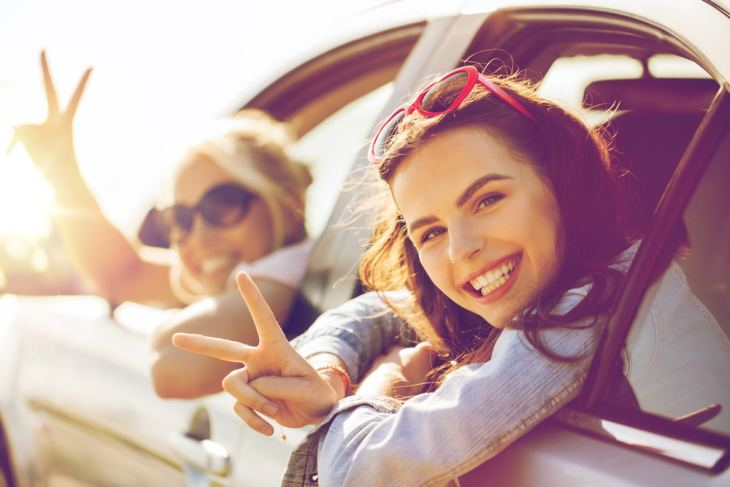 Young girlfriends in car