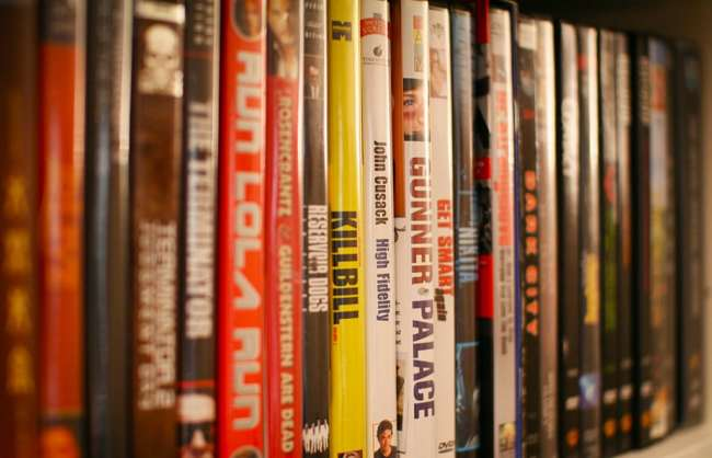 shelf of film dvd boxes