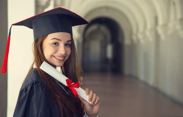 University student in graduation gown