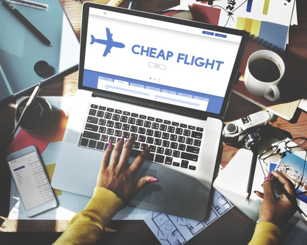 booking cheap flights on laptop