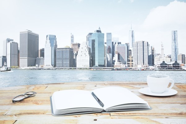 Notebook in front of cityscape
