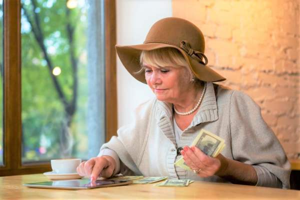 Older woman with cash in hand