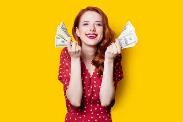 Woman holding handfuls of money