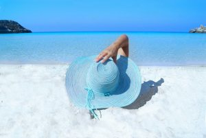 MoneyMagpie_Relax-Beach-Hat-Holiday-Woman
