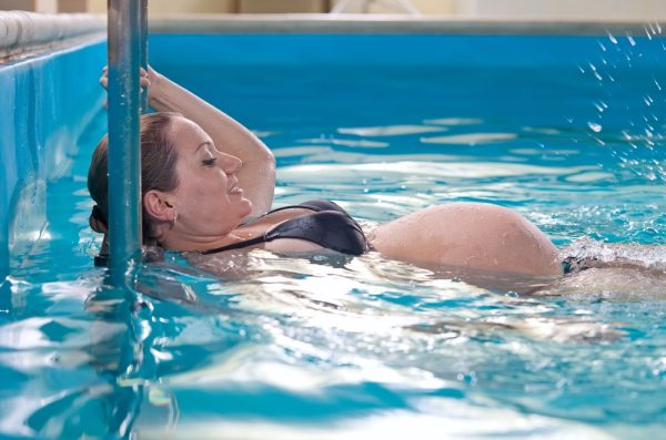 Pregnant woman in swimming pool