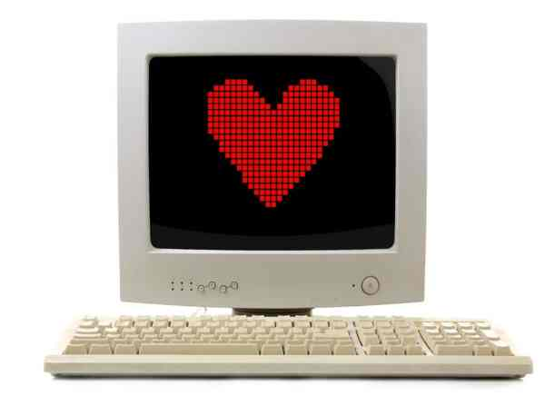Old computer with pixel heart on the screen