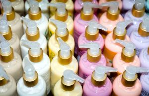 Different coloured lotions in pump bottles