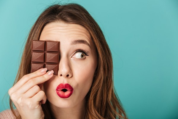 Silly woman holding chocolate