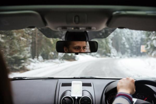 Man driving car on snowy road
