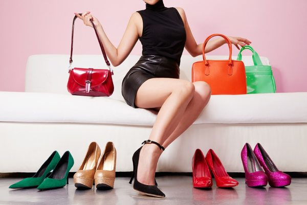 Woman surrounded by bag and shoes for selling