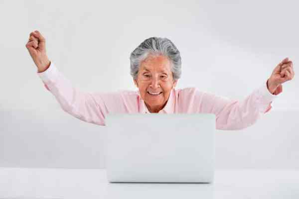 Older lady excited about winning an online competition