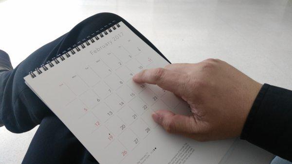 Man looking at his calendar