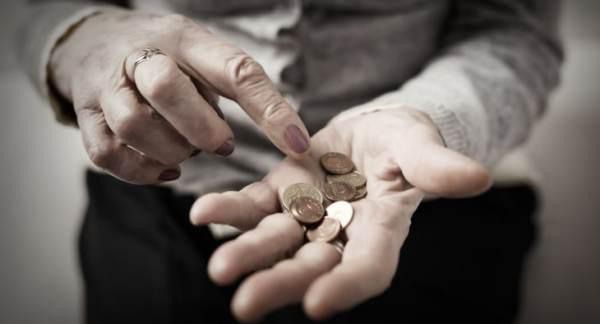 Elderly hands holding cash