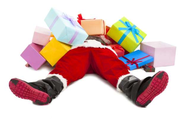 Santa lying on back covered in presents