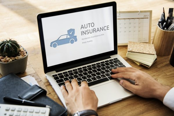 Man looking at car insurance online