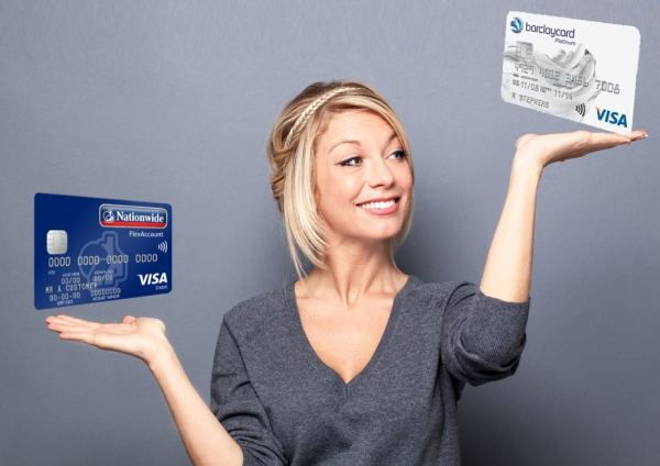 Woman comparing credit cards