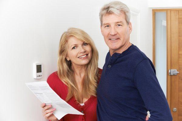 Mature couple assessing bills