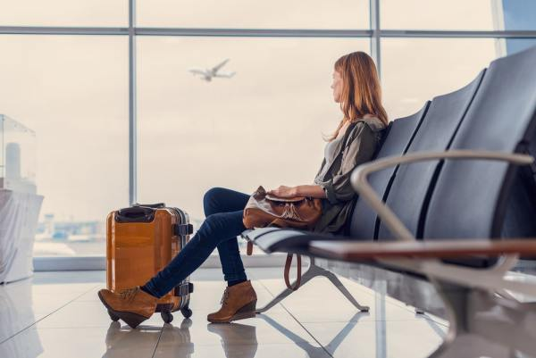 Woman waiting in airport lounge