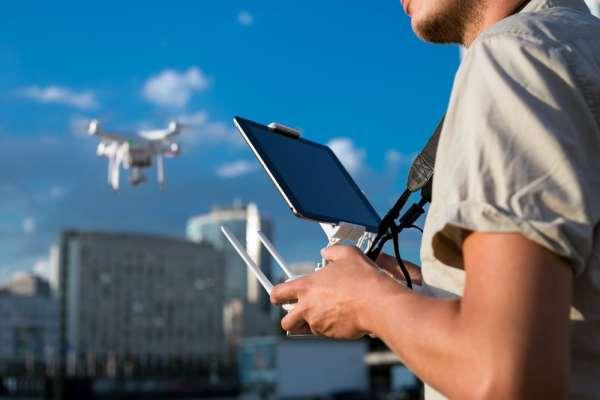 Man piloting a drone