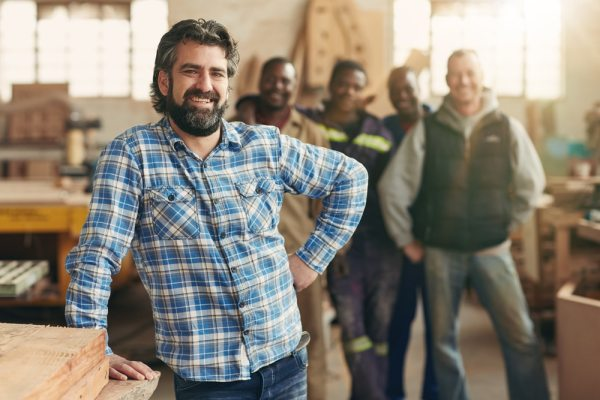 Carpenter with his team of employees