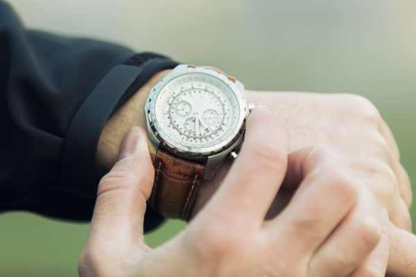 Man checking time on wrist watch