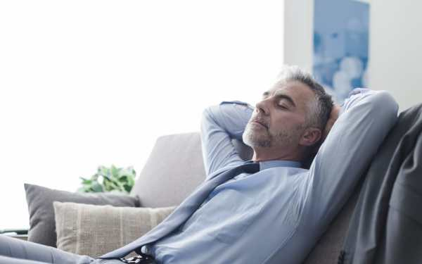 Middle aged man relaxing in a tidy home